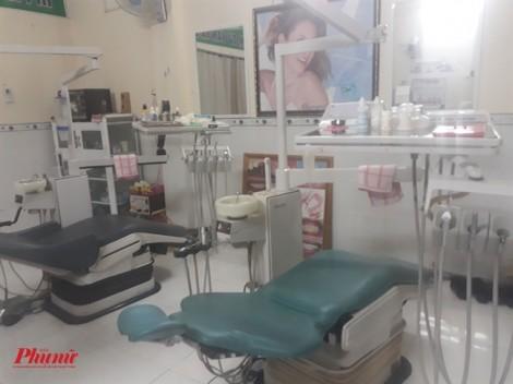 Nha sĩ dỏm gỡ niêm phong, mở phòng khám dụ bệnh nhân