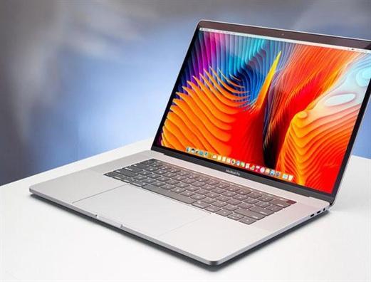 May tinh xach tay Macbook Pro 15-inch bi cam mang len may bay