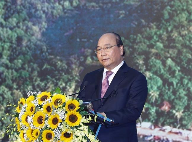 Thu tuong Chinh phu Nguyen Xuan Phuc: 'Viet Nam kien quyet khong danh doi  moi truong de phat trien kinh te, lam anh huong toi phat trien ben vung'