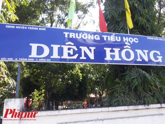 Hoc sinh roi xuong duong tu xe dua don o Dong Nai dang hoc o Truong Tieu hoc Dien Hong