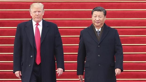 Chung khoan giam manh, dong nhan dan te rot gia sau loi de doa cua Tong thong Trump