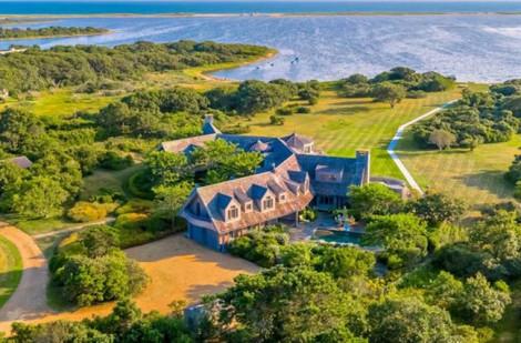 Vợ chồng ông Obama mua nhà… giảm giá