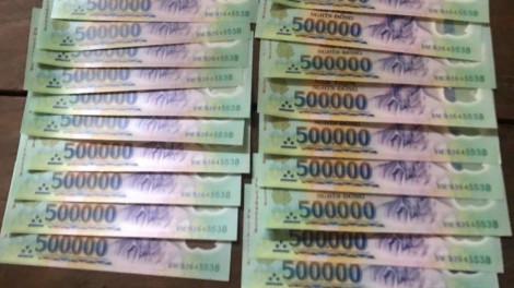 TPHCM: Bắt nhóm đối tượng làm tiền giả, tàng trữ ma túy và 'hàng nóng'