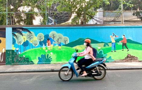 """Chàng trai """"nói chuyện"""" môi trường qua những bức tranh tường"""