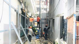 Tháo dỡ chung cư nghiêng 518 Võ Văn Kiệt