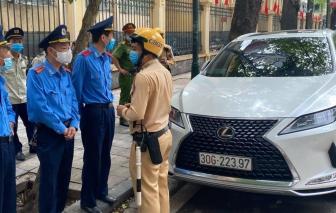 Lái xe Lexus dán biển ra vào Bộ Công an đã hết hạn thách thức tổ công tác