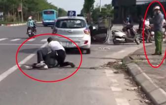 Cảnh cáo cán bộ công an đứng nhìn tài xế taxi vật lộn với cướp