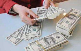 Vì sao Ngân hàng Nhà nước bất ngờ giảm giá mua USD?